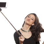 Woman with selfie stick